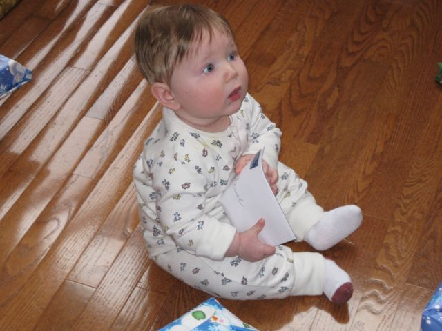 Here he plays with a letter from his Great Grandmother. He never was able to figure out how to open it.