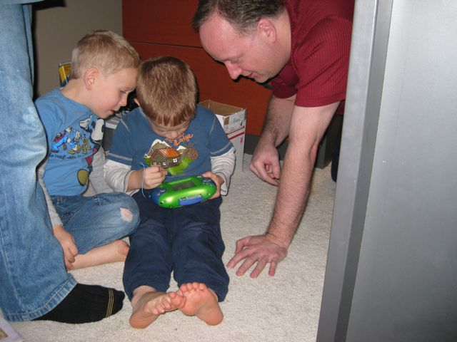 John Paul, Alexander, and Joseph all got Leapster learning game machines. They've been a big hit.