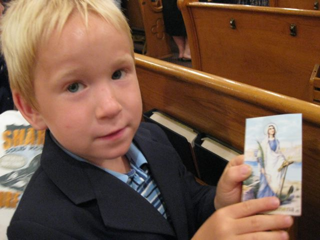 Alexander with a holy card of Philomena.